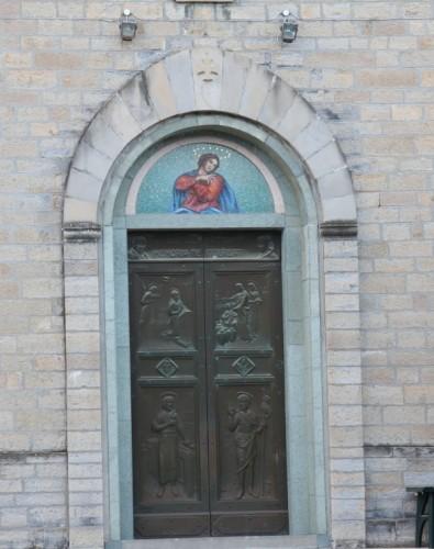 Ferriere - Portale chiesa S. Giovanni Battista
