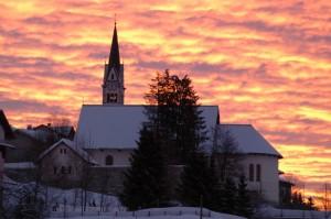 alba sulla chiesa di Luserna