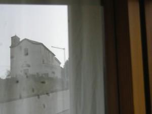 Cappella delle Grazie riflessa nella finestra