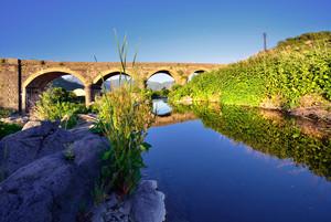Ponte sull'Alcantara con riflessi