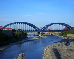The blue railway bridge.