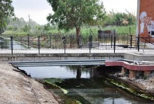 Ponte e condutture a cavallo sul canale delle acque alte
